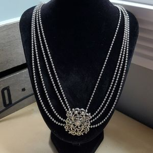 Silver tone four strand necklace